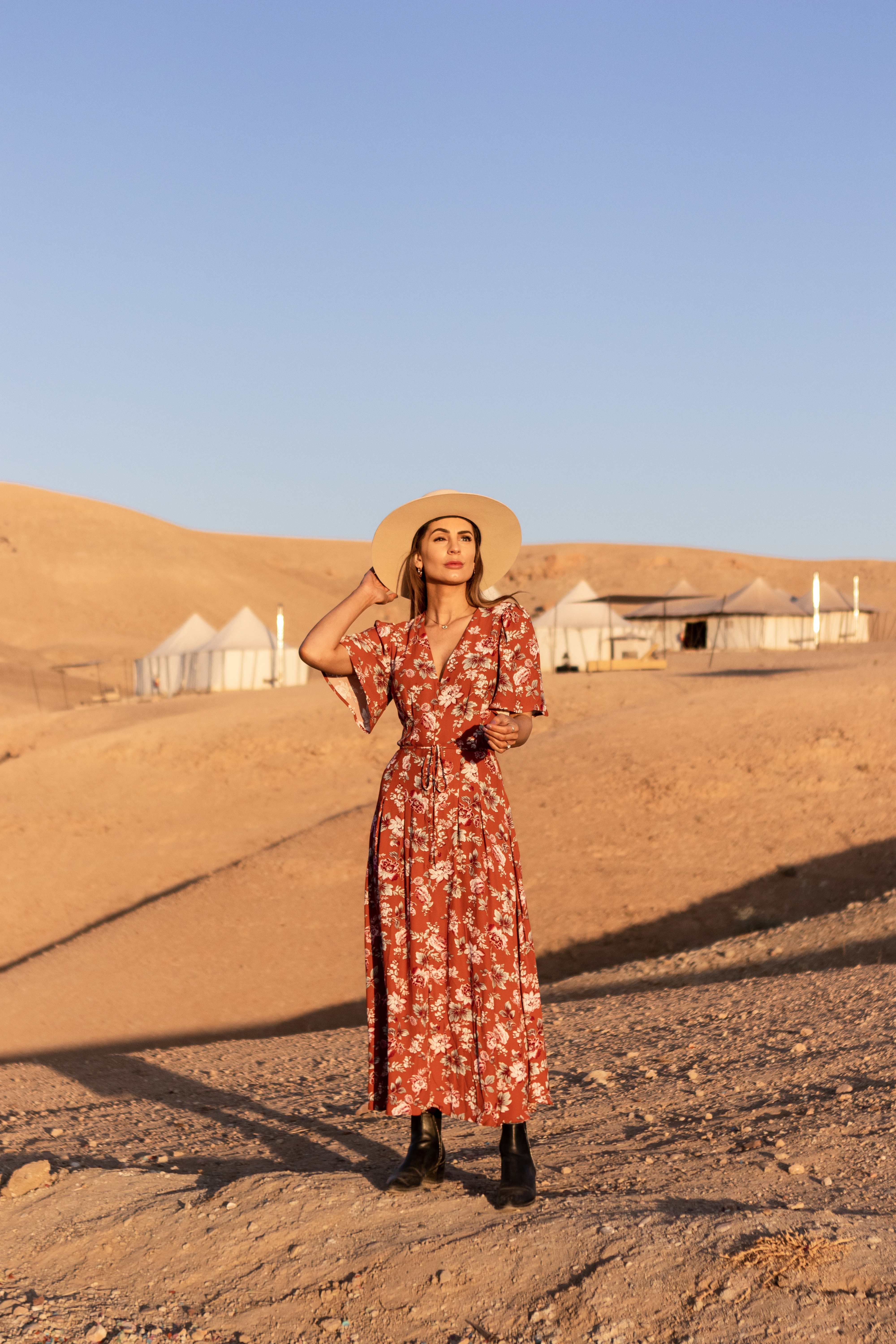 desert, agafay desert, morocco, marrakech, fashion, french connection, maxi dress outfit, lack of color, travel to morocco, travel to marrakech, scarabeo camp, glamping in morocco, glamping in the sahara, desert luxury camp, moroccan rug, moroccan devor,